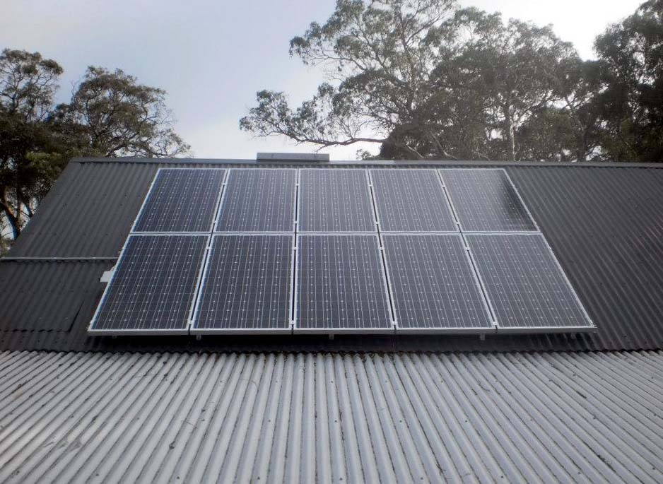 Solar panels on angled galvanised steel roof